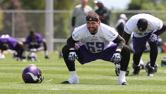 Minnesota Vikings defensive end Jared Allen (69) stretches during training camp at Minnesota State University on July 26, 2013.