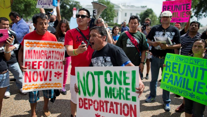 Tomas Martinez, of Atlanta, chants during a rally in front of the White House on July 24, calling for of immigration reform.