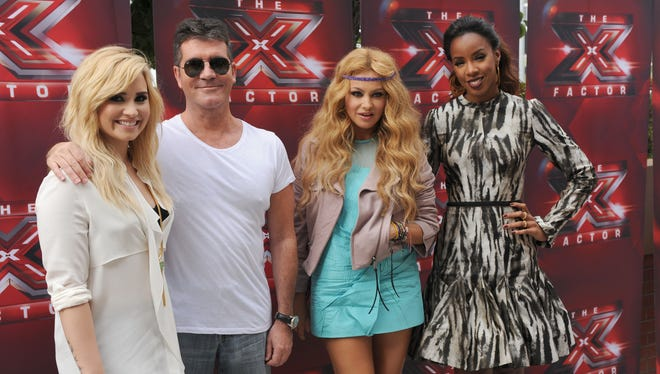 X Factor 3.0: Britney Spears and L.A. Reid are out and Paula Rubio, second right, and Kelly Rowland, right, are joining holdovers Demi Lovato, left, and Simon Cowell at the judges' table.
