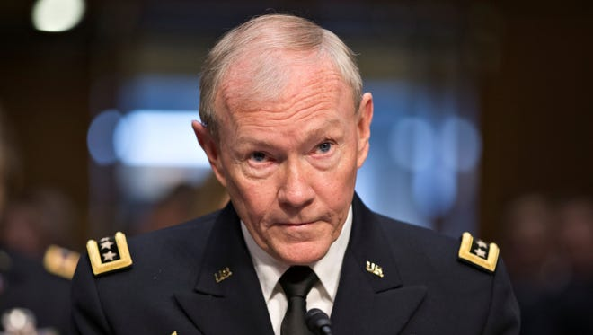 Gen. Martin Dempsey, chairman of the Joint Chiefs of Staff, received tough questioning by Sen. John McCain on July 18.