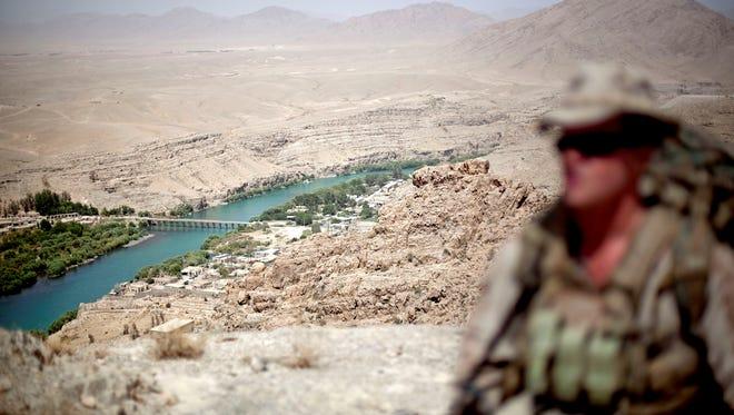 A Marine patrols near the Kajaki River.