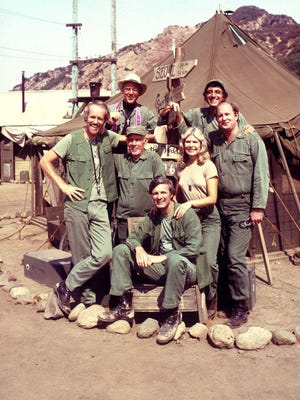The 'M*A*S*H' cast, top row: William Christopher, Jamie Farr; middle: Mike Farrell, Harry Morgan, Loretta Swit, David Ogden Stiers, with Alan Alda seated.