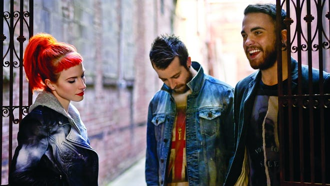 Members of Paramore: Hayley Williams, left,  Jeremy Davis and Taylor York.