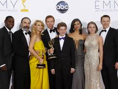 Showtime's 'Homeland' wins the Emmy for best drama, denying 'Mad Men' a record fifth consecutive win.