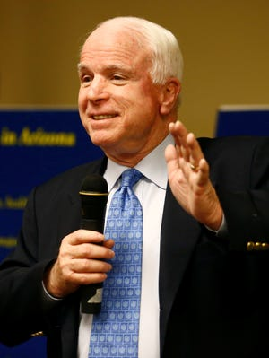 Ariz. Sen. John McCain, R-Ariz., shown at a  Monday, April 29, 2013, town hall in Goodyear, Ariz., is proposing a bill that would allow consumers to pay for single-channel cable programming.