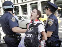 An Occupy Wall Street activist is taken into custody during a march in New York City on Sunday. The Occupy Wall Street movement marks its anniversary on Monday.
