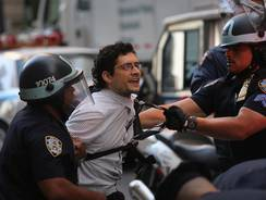A protester is arrested during the one-year anniversary of the Occupy Wall Street movement. Events were planned in more than 30 cities worldwide.
