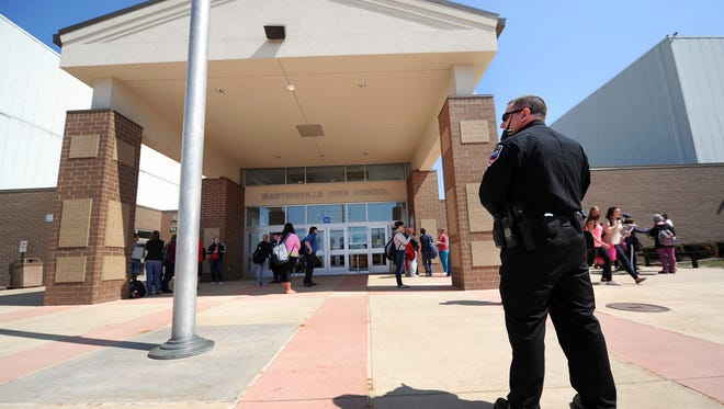Martinsville Police Department Sgt. John Richards serves as an extra safety presence outside Martinsville High School at the end of the day on Friday, April 5, 2013.