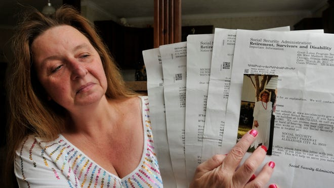 Michelle Clampit, of Wetumpka, Ala., holds a photo of her mother, Alma Autery, and Social Security letters on Tuesday, April 30, 2013,