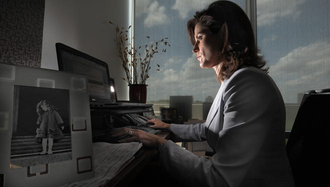 Andrea Lindsley works at her desk at advertising firm DVL 20 years after being diagnosed with multiple sclerosis, an accomplishment she attributes to advances in MS medication.