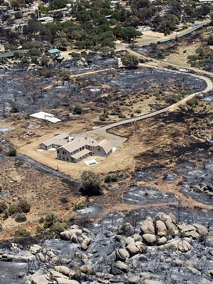 Aerials of Yarnell, Ariz., in the aftermath of the Yarnell Hill Fire show that while hundreds of homes burned, those that had defensible space, areas cleared of brush around the buildings, often were not damaged.