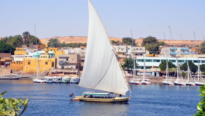 A felucca cruises the Nile River in Aswan, a quiet town in Upper Egypt that has drawn tourists for centuries.