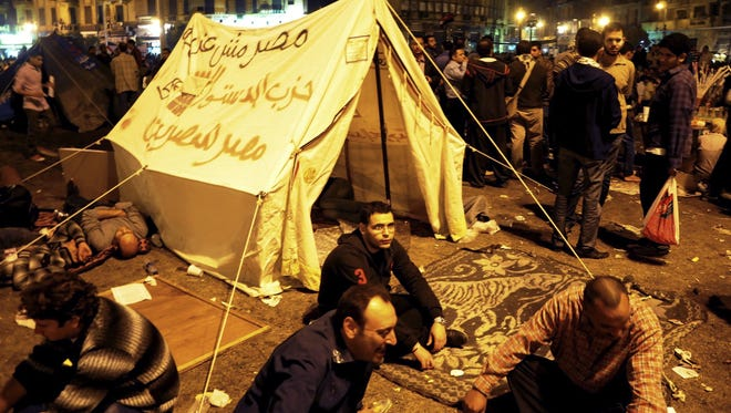 Egyptian pro-democracy demonstrators occupy Cairo's Tahrir Square on Friday.