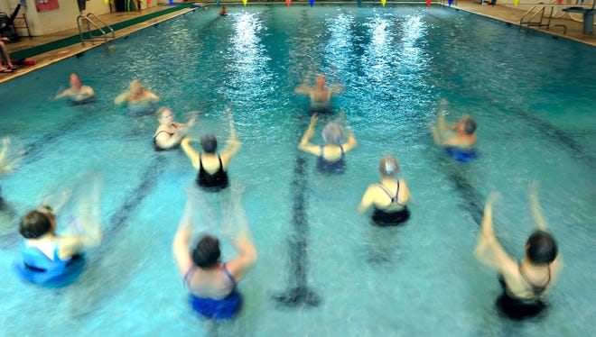 A group of senior citizens are a blur of motion as they participate in a water aerobics class in Georgia.
