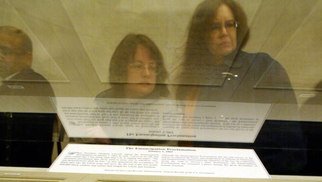 People view the Emancipation Proclamation at the National Archives in January 2004.