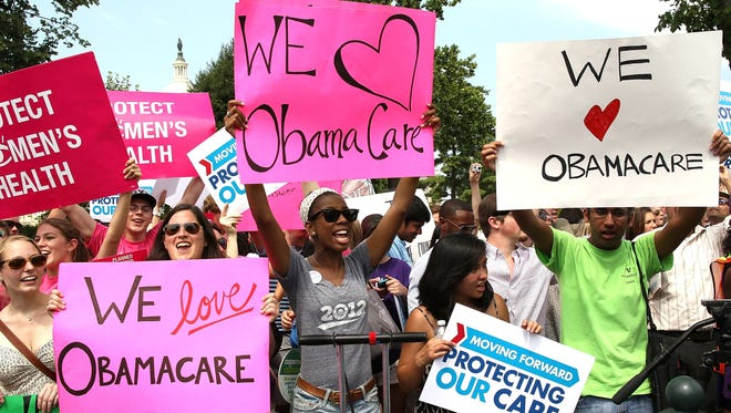 Supporters of the Affordable Care Act celebrate the Supreme Court's decision in June to uphold it.