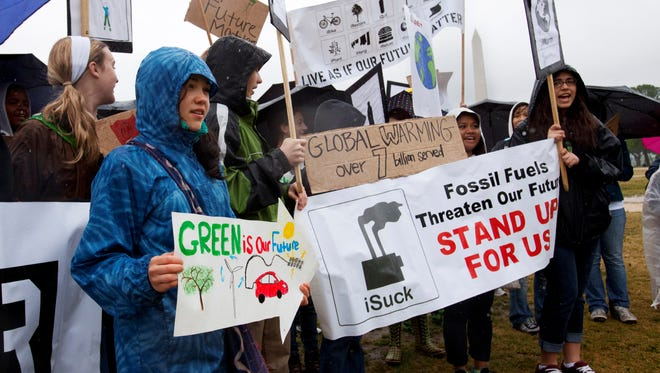 Earth Day activists rally on the National Mall last year.