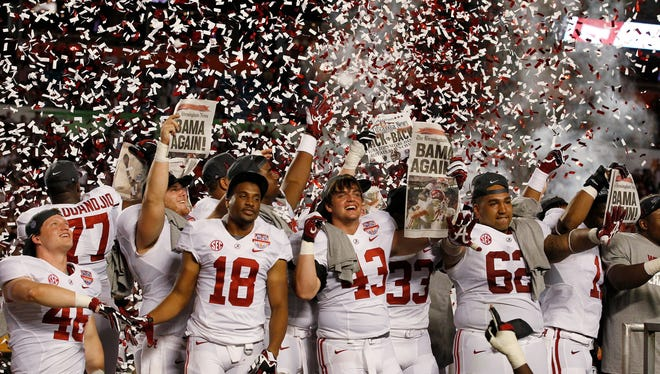 Alabama players celebrate after the BCS National Championship college football game against Notre Dame.
