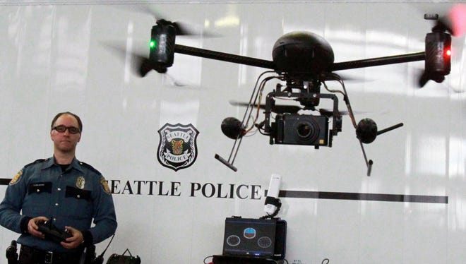 Seattle police officer Reuben Omelanchuk demonstrates last year a radio-controlled drone with a camera.