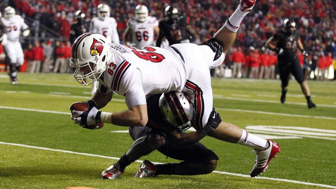 Louisville tight end Ryan Hubbell (83) tries to go over Rutgers defensive back Logan Ryan (11) near the goal line Thursday during the first half at High Point Solutions Stadium in Piscataway, N.J. Louisville won 20-17.