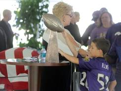 Fans touch the Vince Lombardi Trophy and walk by the casket of former Ravens owner Art Modell.