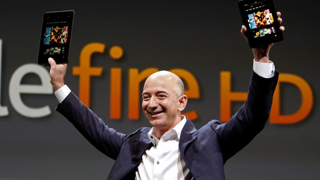 Amazon CEO Jeff Bezos holds the new Amazon Kindle Fire HD at the product's introduction in Santa Monica, Calif., last year.