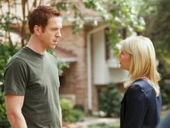 "Damian Lewis portrays Nicholas ""Nick"" Brody, left, and Claire Danes portrays Carrie Mathison in a scene from the Showtime original series, 'Homeland.'"