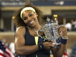 Serena Williams holds the U.S. Open trophy for the fourth time after defeating Victoria Azarenka of Belarus in a three-set final Sunday.