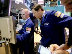 Traders on the floor of the New York Stock Exchange in September 2012.
