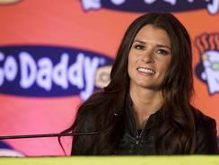 Go Daddy.com spokesman Danica Patrick with the company logo.