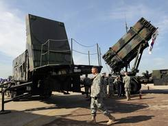 A U.S. soldier walks past the launcher of a Patriot missile PAC-3 system during the Air Power Day at the U.S. airbase in Osan, south of Seoul.