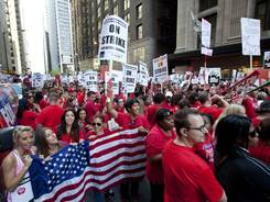Thousands of public school teachers rally outside the Chicago Public Schools district headquarters on the first day of strike action over teachers' contracts in Chicago.