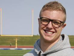 Jamie Kuntz, posing for a photograph Tuesday at a football field in Dickinson, N.D., says he was kicked off the North Dakota State College of Science football team because he was gay. School officials say he was dismissed from the team for lying to a coach.