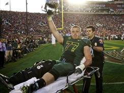 Oregon guard Carson York is taken off the field at the Rose Bowl on Jan. 2 because of a right knee injury. He injured the same knee last week and will miss the rest of his senior season.