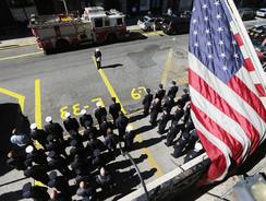New York City firefighters of Engine 33, Ladder 9, observe a moment of silence during ceremonies for the 11th anniversary of the terrorist attacks in Lower Manhattan at the World Trade Center on Tuesday in New York City.