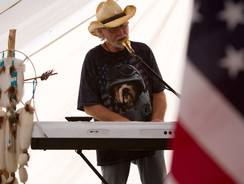 Alan Foote sings 'God Bless the USA' in St. George, Utah. Foote sang the song 911 times in a row to mark the 9/11 terrorists attacks anniversary.