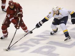 Nashville Predators left wing Colin Wilson (33) blocks the clearing attempt of Phoenix Coyotes defenseman Michal Rozsival (32) during the first period at Jobing.com Arena Monday May 7, 2012 in Glendale, AZ. (Via OlyDrop)