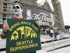 Seattle SuperSonics fan Colin Baxter held a sign outside the Oklahoma City Thunder's arena during the NBA Finals.