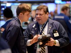 John Santiago, right, of Rosenblatt Securities and a colleague on Wednesday at the New York Stock Exchange.
