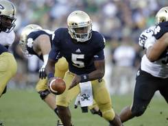 Notre Dame quarterback Everett Golson (5), in Saturday's win vs. Purdue, won't be impacted by the school's move to the ACC. Notre Dame football remains independent.