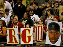 Washington Redskins fans hold up signs for quarterback Robert Griffin III during the second half of a game against the New Orleans Saints at the Mercedes-Benz Superdome on Sept. 9.