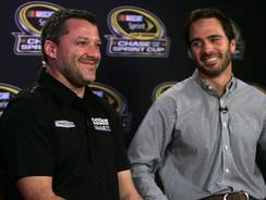 Tony Stewart, left, shares a laugh with Jimmie Johnson during a TV interview Wednesday at the House of Blues in downtown Chicago. The two have won the last seven championships.