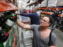 Shoppers fill a new liquor aisle at a Costco warehouse store in Seattle.