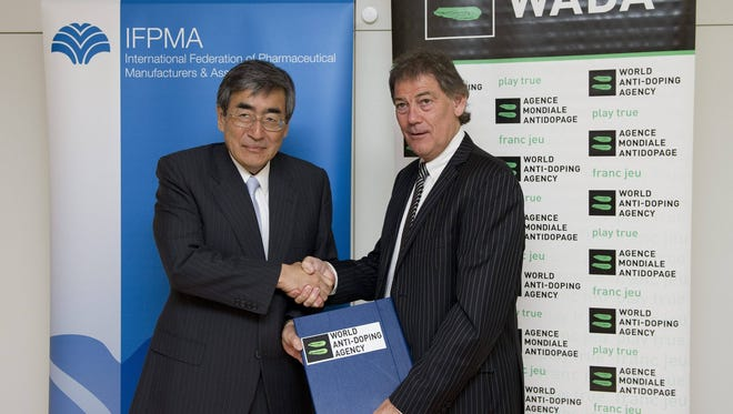 David Howman (right), director general of the World Anti-Doping Agency, WADA, shakes hands after signing a joint declaration, on the cooperation on the fight against doping in sport,  with Japanese Haruo Naito, president of the International Federation of Parmaceutical Manufacturers and Associations, IFPMA, during a symposium in Lausanne, Switzerland, on  July 6, 2010.