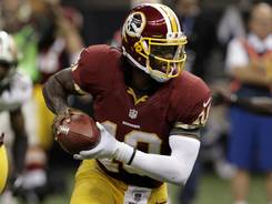 Washington Redskins quarterback Robert Griffin III scrambles in the second half against the New Orleans Saints at the Superdome last Sunday.