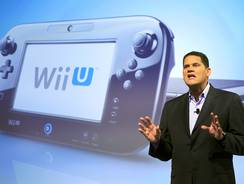 Reggie Fils-Aime, president and chief operating officer of Nintendo of America, discusses the upcoming Wii U gaming console, Thursday, Sept. 13, 2012 in New York. The gaming console will start at $300 and go on sale in the U.S. on Nov. 18, in time for the holidays, the company said Thursday. (AP Photo/Mark Lennihan) ORG XMIT: NYML109