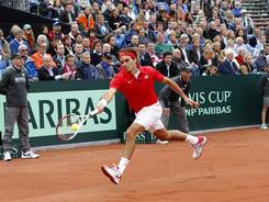Roger Federer of Switzerland chases down a forehand during his victory Friday against Thiemo de Bakker of Netherlands in thei Davis Cup World Group playoffs.
