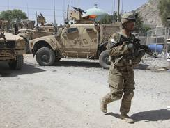 A U.S. soldier, part of the NATO forces, patrols a police station after it was attacked by militants in Kandahar, south of Kabul, Afghanistan on June 19.