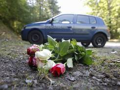 Flowers are seen Sept. 8 at the crime scene where four people were shot to death in a forest near Chevaline in the French Alps.