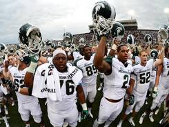 Michigan State players celebrate after their victory against Central Michigan.